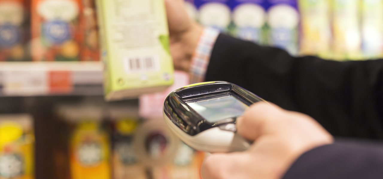 Businessman scanning product with bar code reader